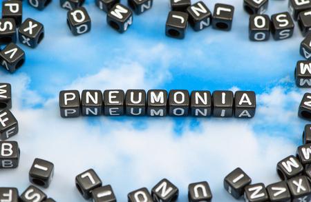 pneumoniae: The word pneumonia on the sky background