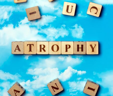 atrophy: The word atrophy on the sky background Stock Photo