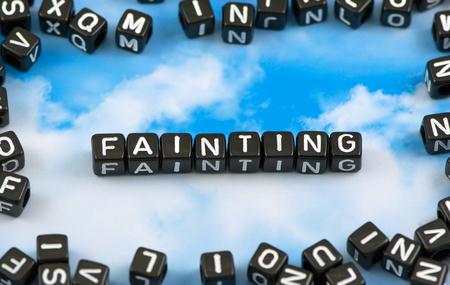 fainted: The word Fainting on the sky background