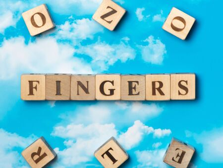 The word Fingers on the sky background