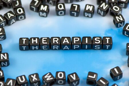 massage symbol: The word Therapist on the sky background