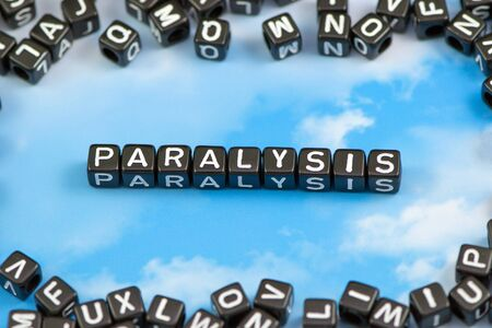 invalid: The word paralysis on the sky background Stock Photo