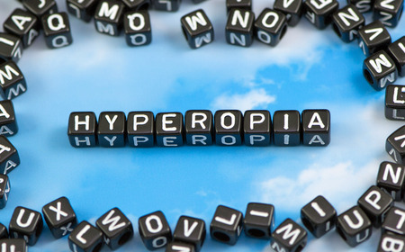 The word hyperopia on the sky background