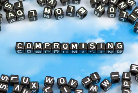 compromising: The word compromising on the sky background Stock Photo
