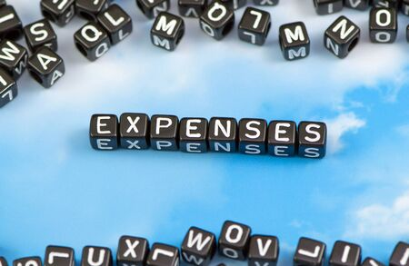The word expenses on the sky background Stock Photo