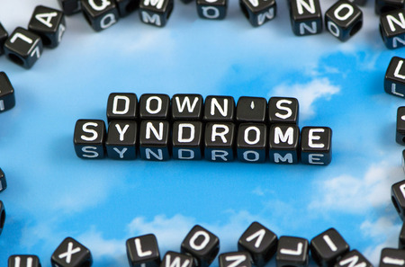 The word Downs syndrome on the sky background