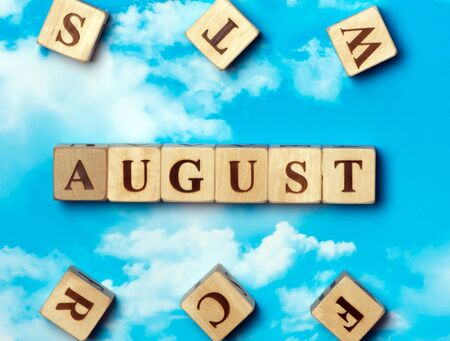 The word August on the sky background Stock Photo