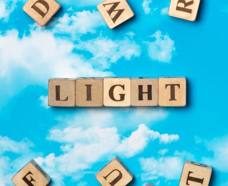 The word light on the sky background