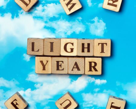 The word light year on the sky background Stock Photo