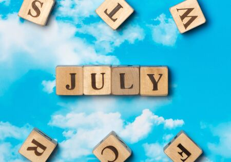The word July on the sky background