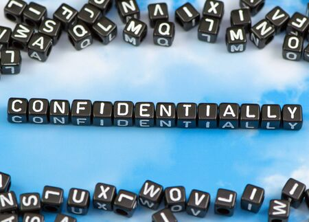 confidentially: The word confidentially on the sky background Stock Photo