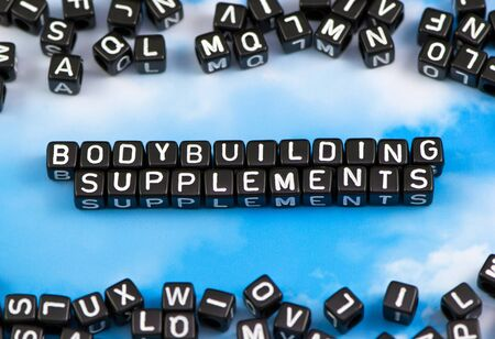 The word Bodybuilding supplements on the sky background