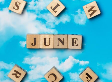 The word June on the sky background Stock Photo