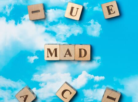 madness: The word mad on the sky background