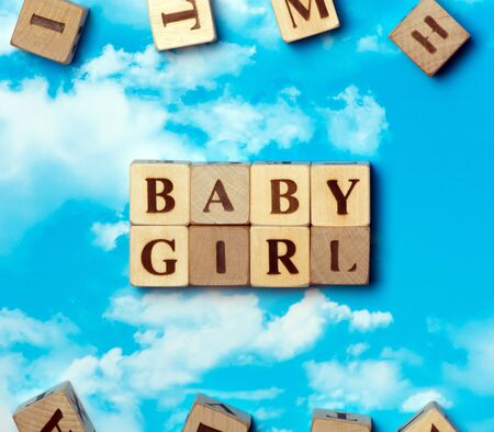 blonde blue eyes: The word baby girl on the sky background