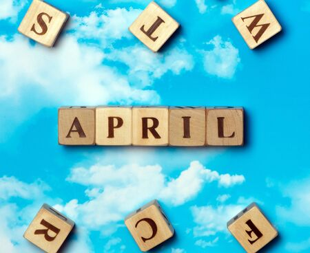 The word april on the sky background