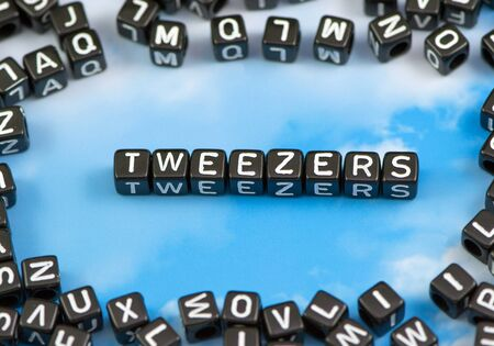 The word Tweezers on the sky background