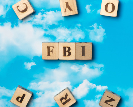The word FBI on the sky background Stock Photo