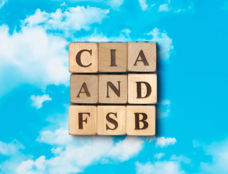 The word CIA and FSB on the sky background