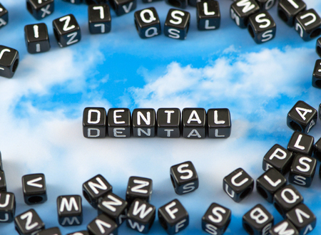The word Dental on the sky background