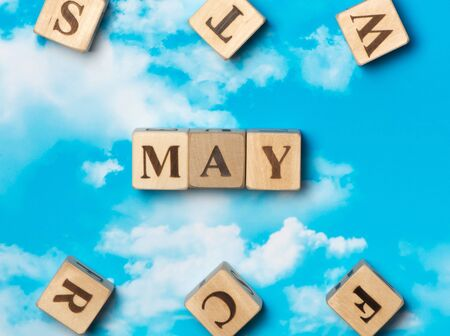 The word May on the sky background
