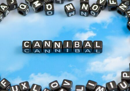 cannibal: The word Cannibal on the sky background