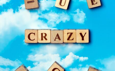 madness: The word Crazy on the sky background