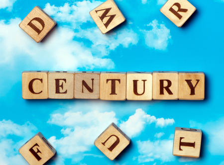 The word century on the sky background
