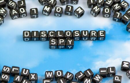 The word Disclosure spy on the sky background