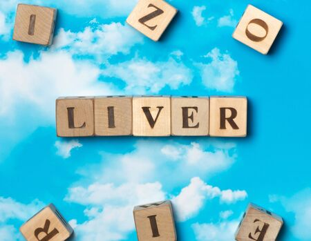 hepatitis: The word Liver on the sky background