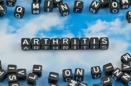 arthritic: The word arthritis on the sky background