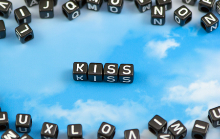 The word kiss on the sky background Stock Photo