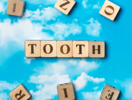 The word Tooth on the sky background