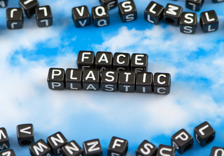 The word face Plastic on the sky background