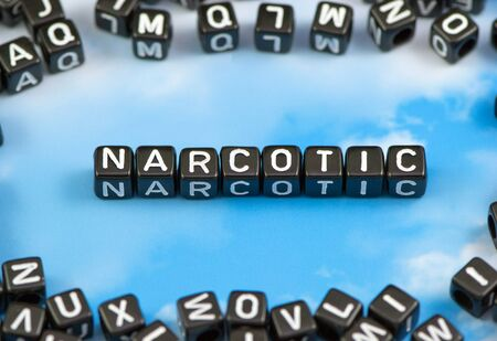 The word narcotic on the sky background