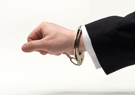 bribes: Handcuffs on the official hand over bribes