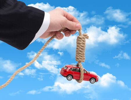 The tax on the car in the form of a gallows in the hand