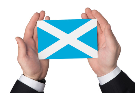 parliament: Flag of Scotland in the hands