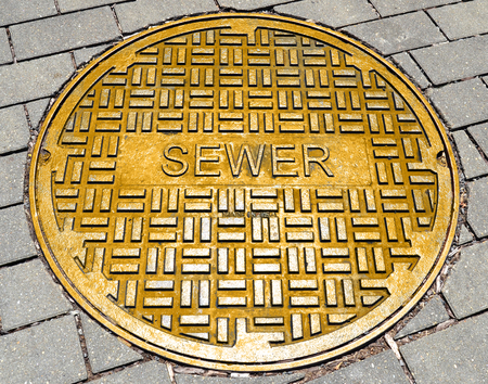 The word sewer on the hatch cover