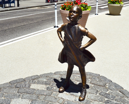Fearless girl in Manhattan during the day