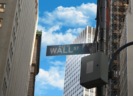 Pointer wall street on the background of buildings