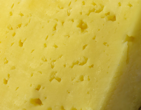 Cheese close-up in the form of a background
