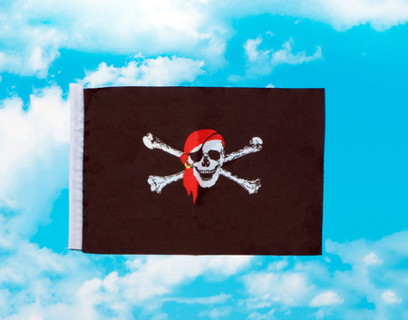Flag pirates against the sky clouds