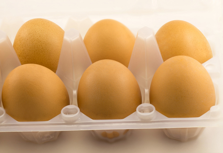 Yellow eggs in a plastic tray