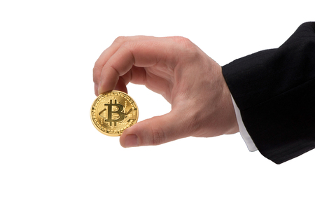 The concept of Bitcoin on a white background in a hand Фото со стока