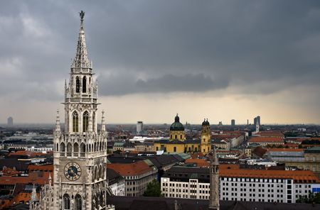 architectural tradition: Dark clouds over Munich city Stock Photo
