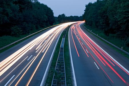 Cars speeding on a motorway photo