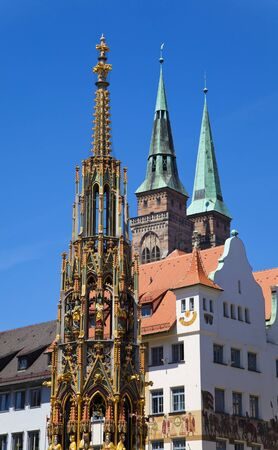 ner: Schöner Brunnen (Beautiful Fountain) and St. Sebaldus Church in Nuremberg (Nürnberg), Germany.
