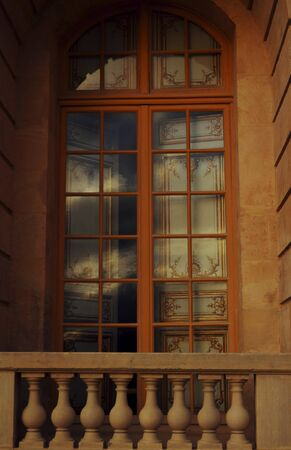 A window that leads towards the outside at Chateau de Versailles (Palace of Versailles). Stock Photo - 58903588