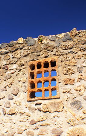 timeless: Detail from the stonewall of an old citadel on the Amalfi coast.